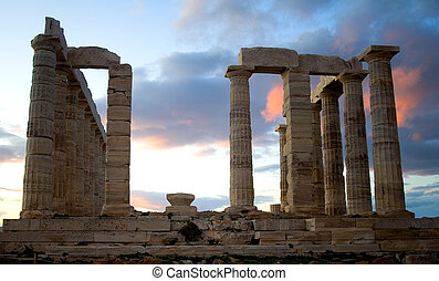 Temple of Poseidon on Sounion cape in Greece at sunset The...