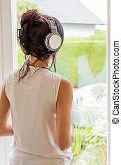 woman listening music with headphones relax and unwind