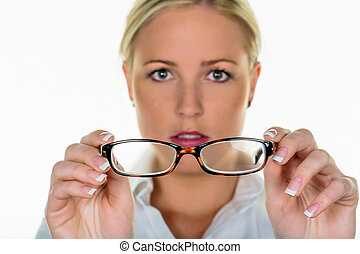 woman holding a pair of glasses - a woman holding glasses in...