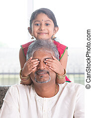 Daughter playing with father