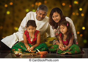 Family celebrating Diwali - Indian family in traditional...