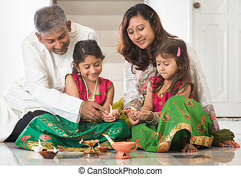 Indian family celebrating Diwali - Indian family in...