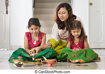 Celebrate Diwali festival - Indian family in traditional...