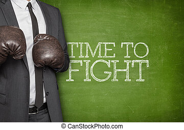 Time to fight on blackboard with businessman on side - Time...