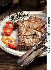 Fried beef steak. - Fried beef steak in a plate. Selective...