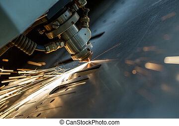 Laser cutting of metal sheet, close-up - Image of laser...