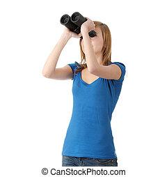 Teen girl with binocular isolated on white