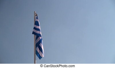 Request Greece flag in front of a blue sky