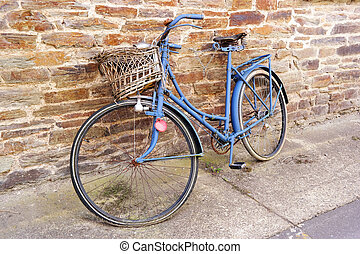 Vintage ladies bike - An old weathered blue bicycle with...