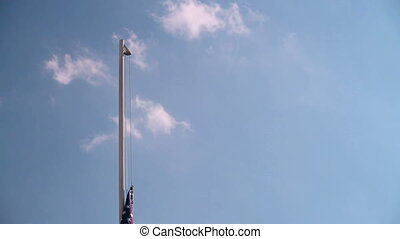 Hoist USA flag with blue sky