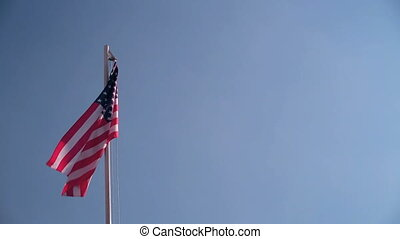Request USA flag in front of blue sky