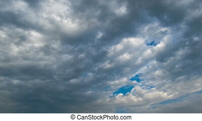 Storm clouds moving in the blue sky - White, rain, gray,...
