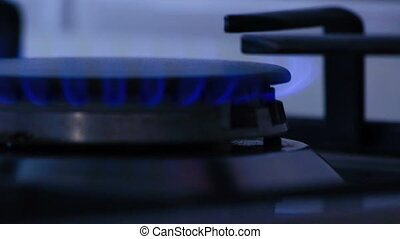 Natural gas inflammation in stove burner, close up view of...