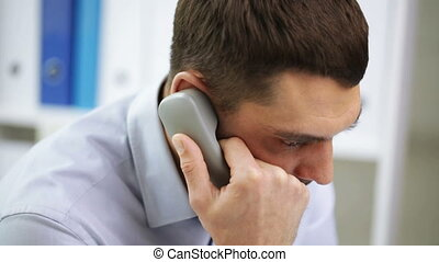 angry businessman calling on phone at office - business,...