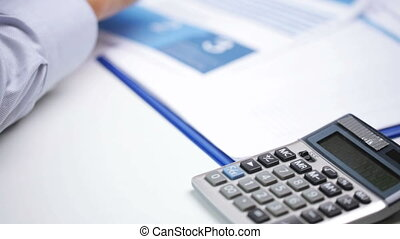 businessman hand with calculator and papers - business,...