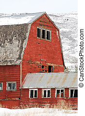 Old Red Barn - Old large red barn in the snow.