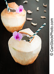 Coconut juice - Fresh Coconut juice on blackwood background