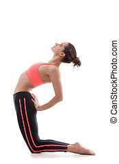 Sporty girl bends backwards - Sporty yoga girl stands on her...