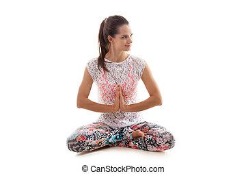 Yoga pose sukhasana - Smiling Yoga girl on white background...