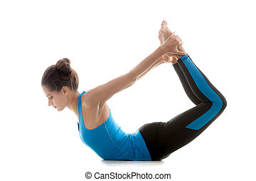 Yoga pose dhanurasana - Sporty yoga girl on white background...