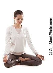 Yoga asana sukhasana - Yoga girl on white background in...