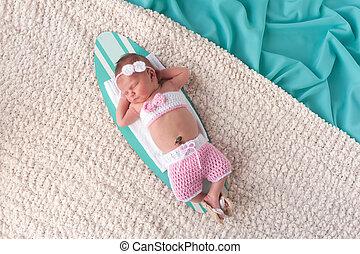 Newborn Baby Girl Sleeping on a Surfboard - Nine day old...