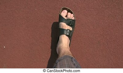 Man in leather slippers walking - Adult caucasian man in...