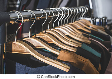 Clothes on hangers in shop