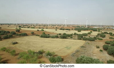 Wind turbines aerial view sliding right to left - Aerial...