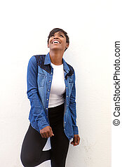 Smiling african american woman looking up