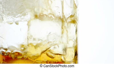 fresh fizzy coke in the glass with ice, close up view on...