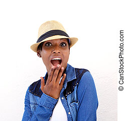 Young woman with surprised expression on face