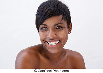 African american beauty smiling - Close up portrait of an...