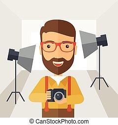 Photographer inside his studio.