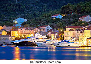 Luxury yachts in Town of Vis waterfront evening view,...