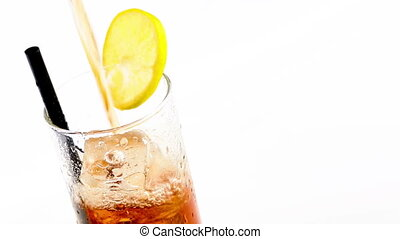 pouring fresh coke with lime slice and ice cubes isolated on...