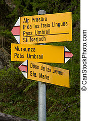 Sign post on hiking trail in switzerland