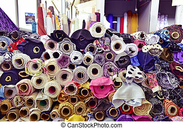 fabric on sale in a street market, filtered