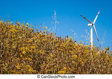 windmills on blue sky