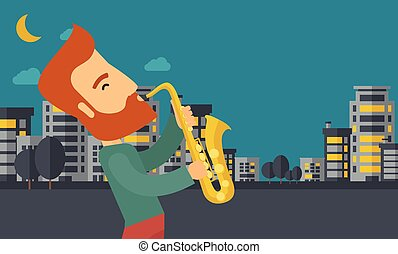 Saxophonist playing in the streets at night - A caucasian...
