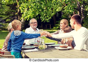 happy family having holiday dinner outdoors - family,...