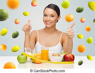 happy woman with healthy food showing thumbs up