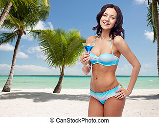 happy young woman in swimsuit drinking cocktail - people,...
