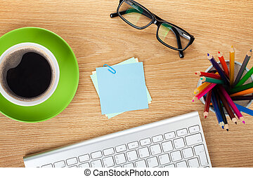 Blank post-it with office supplies and coffee cup