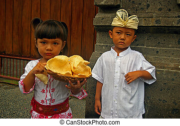 Traditional Balinese children - Indonesian children, wearing...