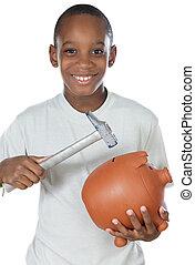 Boy breaking a money box
