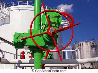 green valve on a gasoline storage tank background