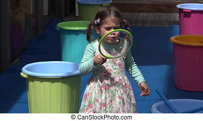 Gilrl blow and play with big soap bubbles balloons - Little...