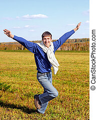 Happy Teenager in the Field - Cheerful Teenager run in the...