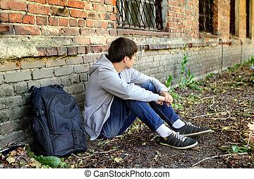 Sad Teenager outdoor - Sad Teenager near the Brick Wall of...